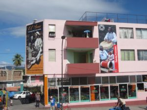 Newly painted building on Avenida Garzón. Photo by Rebecca Bodenheimer.